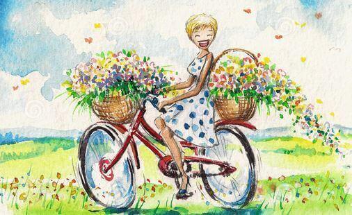 Uśmiechnięta kobieta na rowerze