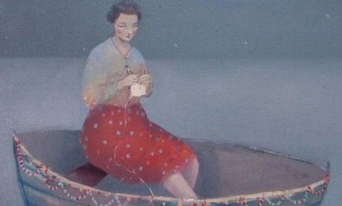 ręczne robótki - kobieta szydełkująca na łódce w fazie flow