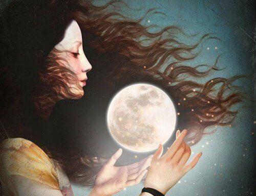 Kobieta trzymająca księżyc