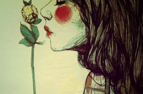 Kobieta wącha kwiat
