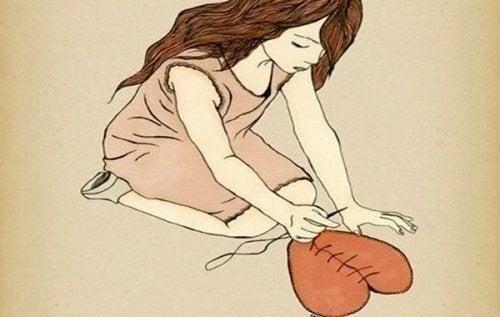 Kobieta zszywająca serce - mówienie o uczuciach