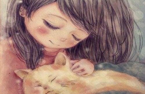 Dziewczynka głaszcząca kota.