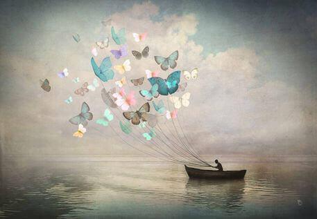 Statek na jeziorze i motyle kolorowe
