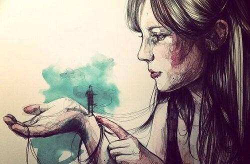 Kobieta z mężczyzną na dłoni