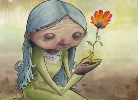 Starsza kobieta z kwiatkiem