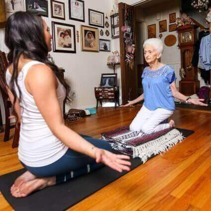Yoga training by an older woman with a trainer