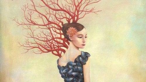 Kobieta i drzewo bez liści