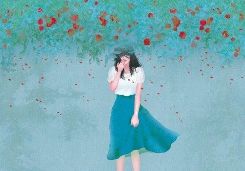 Kobieta w kwiatach i jej samotność