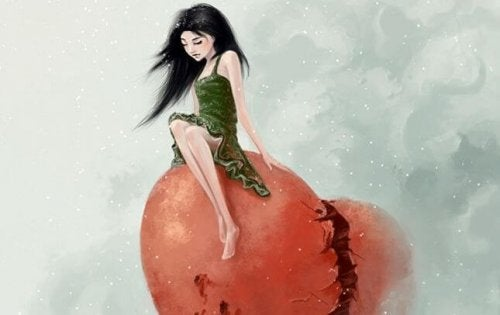 Kobieta siedząca na złamanym sercu