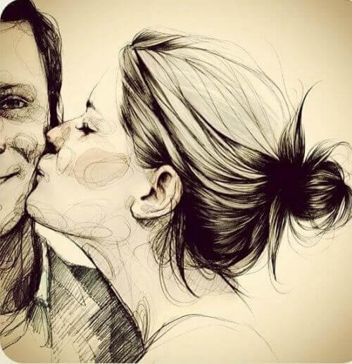 kobieta całuje mężczyznę w policzek
