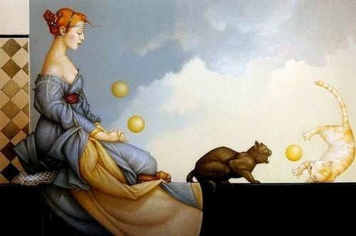 Kobieta bawi się z kotem - wspólny czas