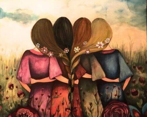 Przytulone kobiety na łące