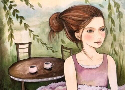 Kobieta i stół z postawioną kawą