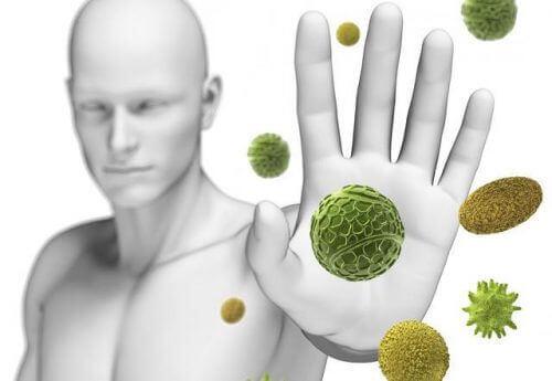 Stop wirusom i bakteriom, człowiek blokuję ręką wirusy, układ odpornościowy