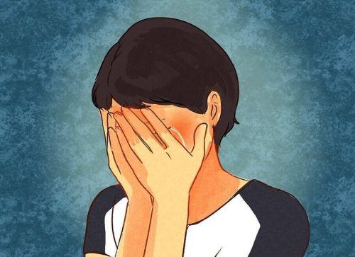Kobieta trzyma się za twarz - zaburzenie afektywne dwubiegunowe