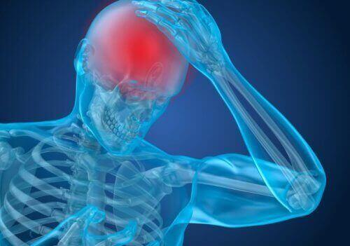 Osoba z bólem głowy