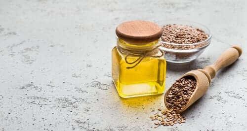 Słoik z olejem i ziarnami - sprzężony kwas linolowy